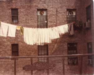 Anna's laundry strung on the clothesline attached by pulleys to the tenement behind ours.